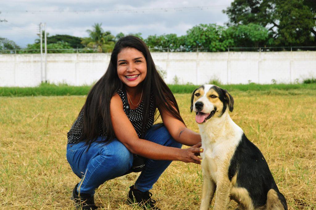 Woman beside dog.